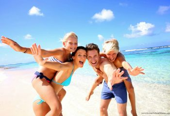 shutterstock_family_of_4_on_beach_resize