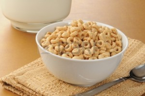 14667071-a-simple-bowl-of-cold-cereal-next-to-a-picture-of-milk