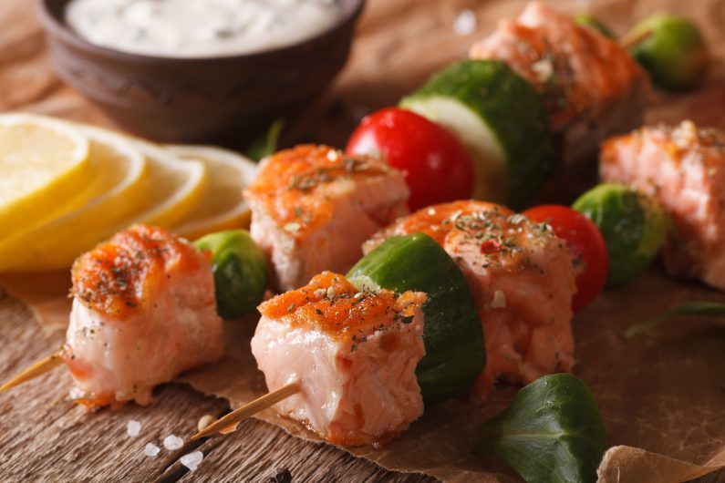 Grilled Salmon On Skewers And Tartar Sauce Macro. Horizontal